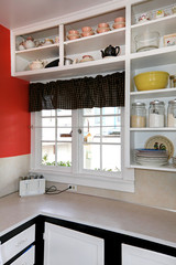 Old simple white kitchen with brick wall.