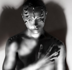 Man's Silver Body in Shadows. Thorns Silhouette. Creative Design