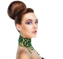 Stylish Woman with Green Gems. Luxury. Aristocratic Profile