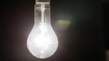 Real light bulb turning on, flickering and turning off.