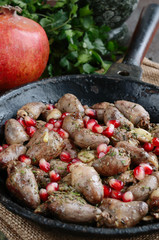 Fried chicken hearts with pomegranate in Georgian style