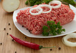 minced meat on the wooden cutting board
