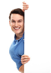 Man peeping over blank poster