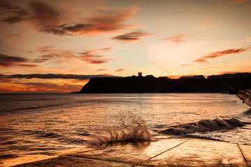 Sunrise on Scarbourgh's North Beach with the castle Silhouetted