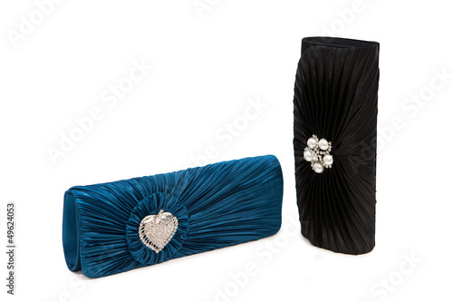 Luxurious clutch bags isolated on white