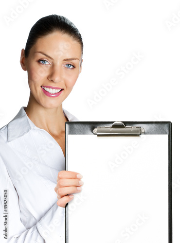 Businesswoman showing blank clipboard, on white