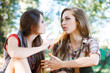 two girlfriends outdoor talking