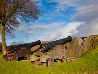 Two Antique Cannons in a Fortified Town