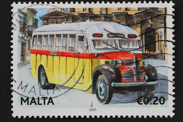 Malta - circa 2011;stamp shows traditional classic Maltese bus