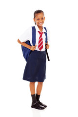 elementary schoolgirl full length isolated on white