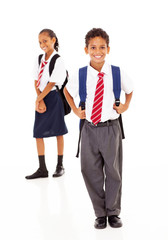 two primary school students standing on white