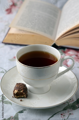 With a Cup of tea on a stack of books