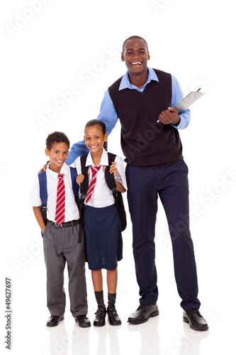 elementary school teacher and students full length portrait