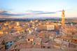 Siena sunset panoramic skyline. Mangia tower landmark. Tuscany,