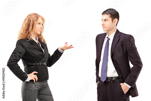 Mature female in a formal wear having a conversation with a youn