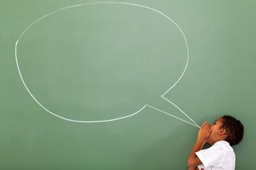 elementary schoolboy shouting at chat box drawn on chalkboard