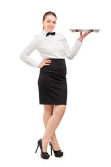 Full length portrait of a waitress with bow tie holding an empty