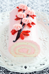 Roll cake with strawberry cream, vanilla, and goji berries
