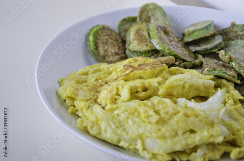 Omelet with fried eggplants vegetables