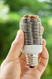 coin light bulb,energy concept