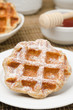 homemade waffles topped with powdered sugar for breakfast