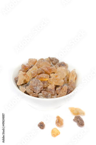 sugar candy in a white bowl isolated on a white background