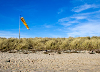 Windsock and beach. (Findhorn beach, Scotland.)