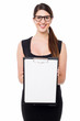 Cute business executive showing blank clipboard