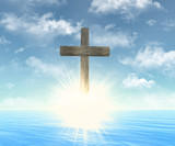 wooden cross in front of sun
