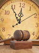 Wooden gavel and clock