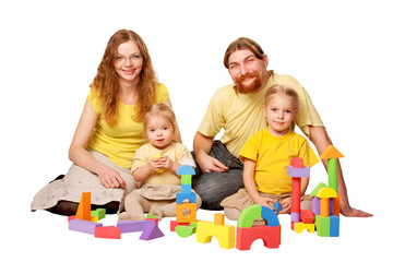 Happy father, mother and two children