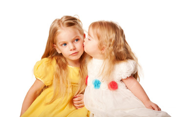 Younger sister kissing elder sister.