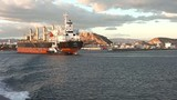 Bulk carrier tugged to port stern view