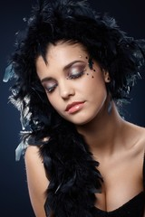Girl with sparkly makeup and black boa