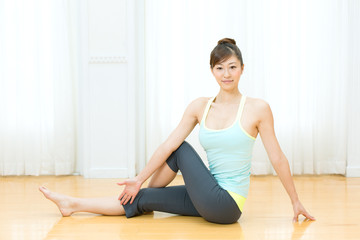 Beautiful young woman doing yoga exercise