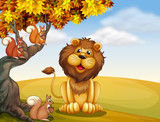 A lion with three squirrels at the hilltop