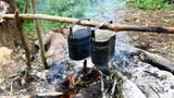 cooker food in pots on fire at camping place