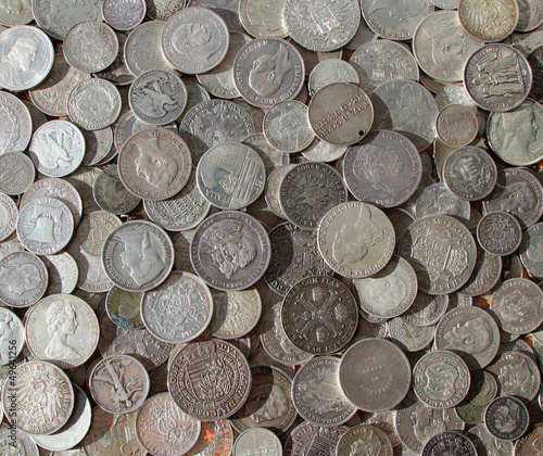 Ancient silver coins in a background photo