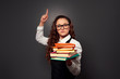 funny teacher in glasses with pile of textbooks