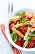 Penne with roasted cherry tomatoes, capers and basil