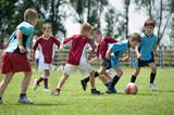 Fototapety kids playing football outside