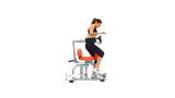 Slender brunette exercising on trainer