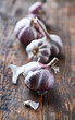 Garlic bulbs on old wooden surface