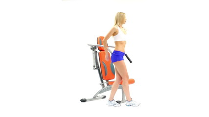 Beautiful slim woman on modern gym equipment
