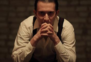 Portrait of young serious mafia man