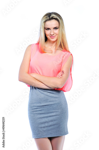 Beautiful woman with arms crossed isolated on white background