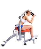 Slim woman on isodynamic exerciser