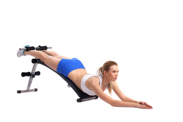 Young woman shakes press on exerciser