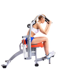 Slim woman on isodynamic exerciser