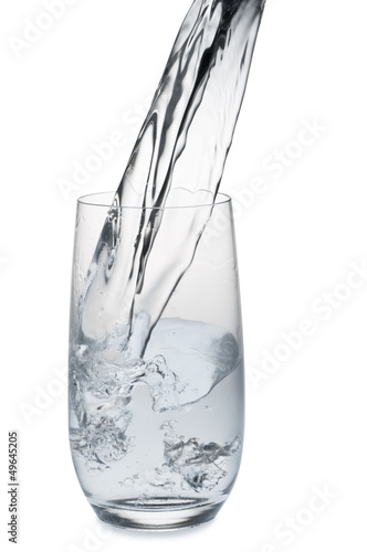 Water stream being poured into a glass